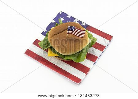 Hamburger on an American flag napkin and toothpick