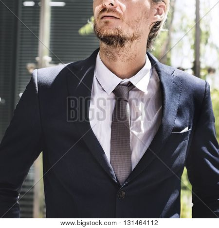 Business Man Contemplating Outdoors Concept