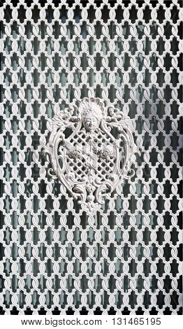 White ornamental grille with wrought pattern. ornament