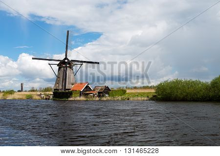 Kinderdijk windmill on a canal in the Netherlands.