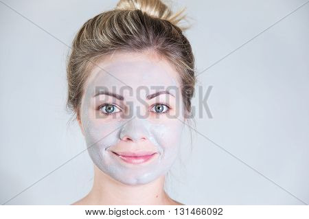 Cosmetic procedure. Cleansing mask on the face of the girl. Power skin. Closeup portraite
