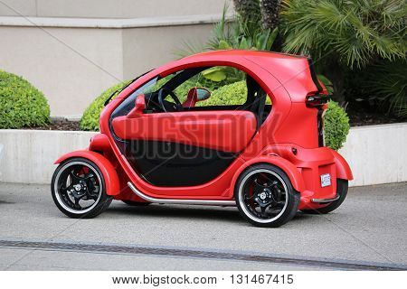 Monte-Carlo Monaco - May 18 2016: Red and Black Electric Car Renault Twizy (Tuning) Parked in Front of the Grimaldi Forum in Monaco.