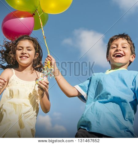 Happy Boy Girl Dozen Helium Balloons Playful Concept