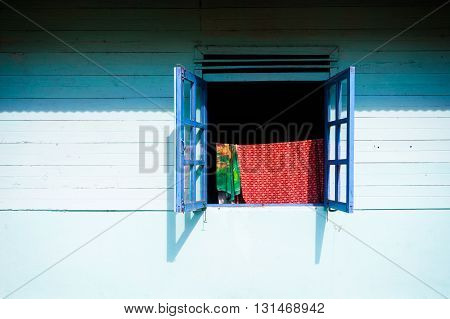 Traditional blue wooden wall with square window, Sumatra, Indonesia