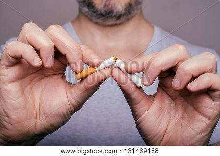 Quit Smoking - Male Hand Crushing Cigarette