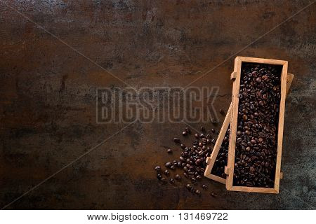 Wooden Containers Filled With Cofee Beans On The Rust Background