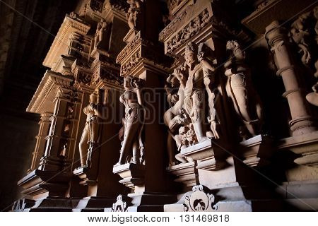 The Cultural Heritage of India - sculptures made of sandstone representing apsaras and deities in Kandariya Makhadeva temple Khajuraho Madhya Pradesh province.