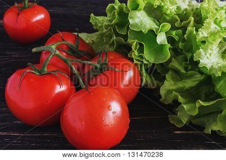 Tomatoes On Vine And Salad