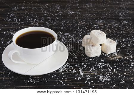 Cup Of Coffee And Rahat Lokum With Coconut On Black Wooden Background