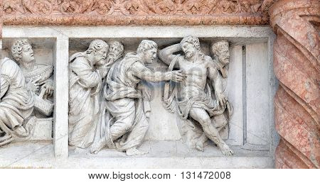 BOLOGNA, ITALY - JUNE 04: Doubting Thomas by Zaccaria da Volterra, door of San Petronio Basilica in Bologna, Italy, on June 04, 2015