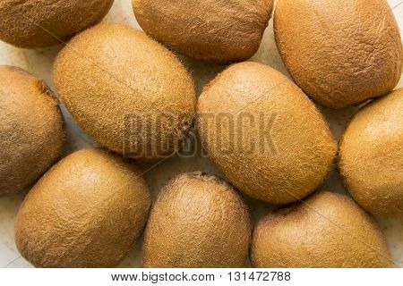 Exotic juicy, fresh Brown, hairy Kiwi fruit on a white background.