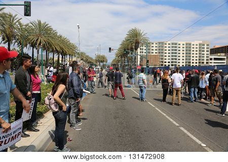 ANAHEIM CALIFORNIA, May 25, 2016: Protesters yell argue with supporters, wave signs and cause trouble for the police at the Republican Presidential Candidate Donald J. Trump rally 5.25.2016