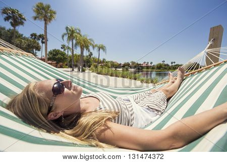 Woman relaxing in a hammock while on vacation