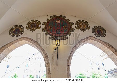 Krakow, Poland- May 25, 2016: Market near Church of Our Lady Assumed into Heaven. Is a Brick Gothic church re-built in the 14th century. With tourists on square