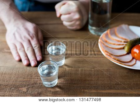 Shot Glasses Of Vodka On A Wooden Table