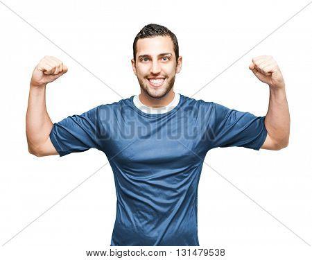 Athlete wearing blue uniform celebrating on white background