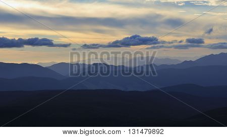 View from Mt Robert New Zealand. Back-lit mountain ranges just after sunset. Summer scene in the Southern Alps.