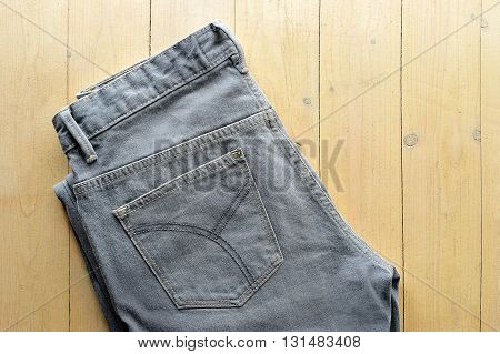jeans gray on a yellow wooden background
