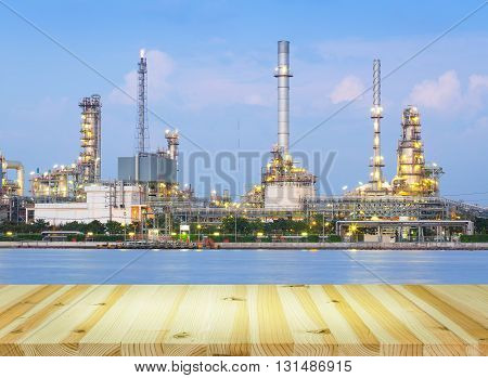 Oil refinery at twilight with wood floor.