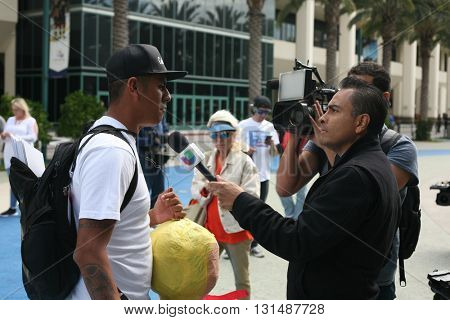 ANAHEIM CALIFORNIA, May 25, 2016: The various news media personel interview supporters and protesters about the Presidential Candidate Donald J. Trump at the Anaheim Convention Center rally on.