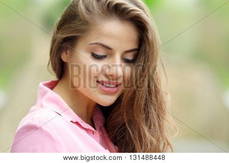 Attractive young woman on blurred background