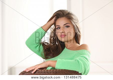 Beautiful long-haired woman on light background