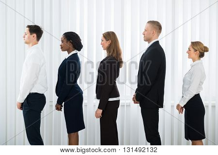 Group Of Businesspeople Doing Various Activities While Waiting For Interview