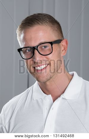 Portrait Of Young Happy Man Wearing Eyeglasses