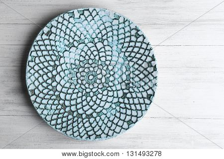 Empty plate on wooden background, top view