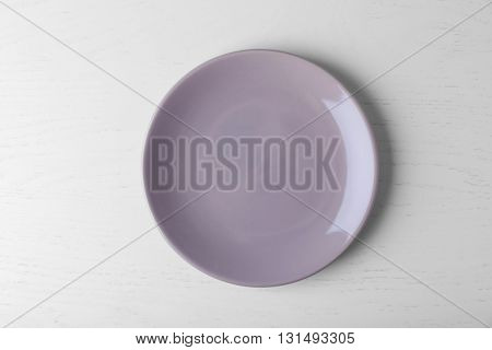 Empty plate on white wooden background