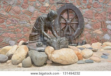 PUERTO VALLARTA MEXICO MAY 07 2016: Washer Woman bronze statue by Jim Demetro, placed in 2008 near the Cuale River bridge and in front of the Molino de Agua condos along the malecon boardwalk