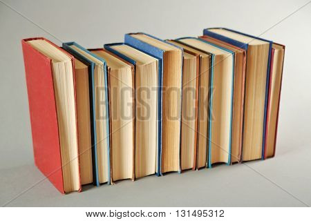 Book collection on grey background