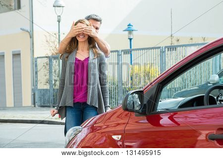 Man Giving Surprise To Her Wife By Purchasing A New Red Car