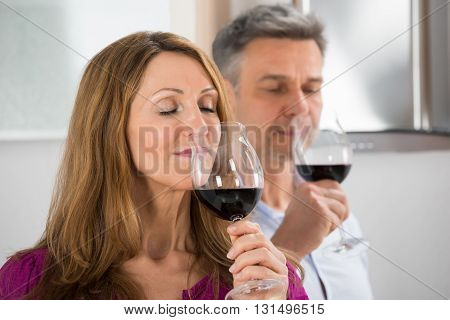 Close-up Of Couple Tasting Glass Of Wine