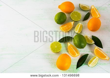Limes and lemons on black background copy space. Fresh food. Ripe fruit. Citrus fruit. Vegetarian food. Fresh fruit. Mixed fruit. Fruit background.
