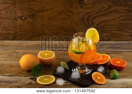 Fruit cocktail on wooden table copy space. Fruit cocktail. Fruit drink. Summer drink. Citrus lemonade. Fruit lemonade.