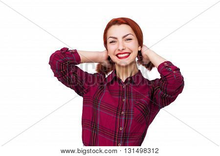 Happy young woman holding her red srtaight hair isolated on white background