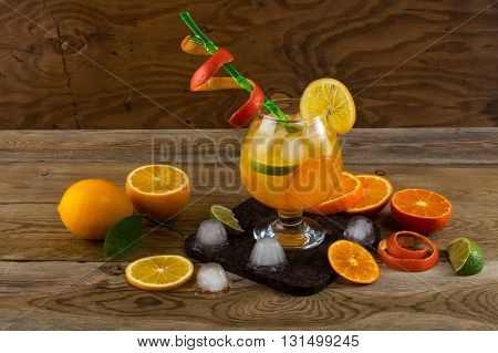 Tropical fruit cocktail on wooden table. Fruit cocktail. Fruit drink. Summer drink. Citrus lemonade. Fruit lemonade.