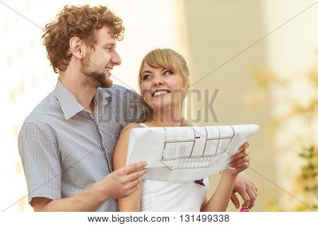 Couple With Blueprint Project  Building Plans Outdoor