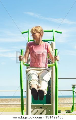 Active Woman Exercising At Outdoor Gym.