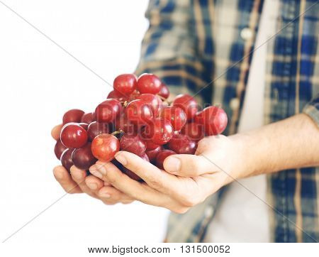 Man holding big bunch of grapes