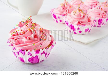 Pink delicious cupcakes.Selective focus. Birthday cupcakes. Homemade cupcake. Sweet cupcake. Gourmet cupcakes. Sweet dessert. Sweet pastry.