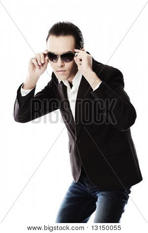 Portrait of a handsome young man in elegant suit and sunglasses.