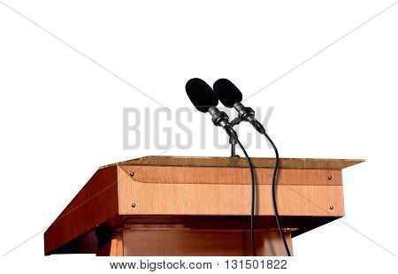 Microphones on the podium over white background