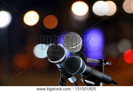 Microphones with blur lights background in a hall