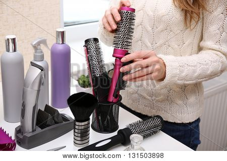 Professional hairdresser and her tools