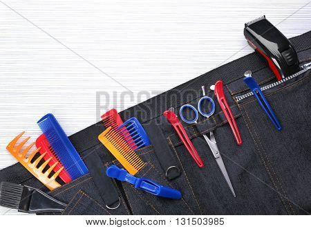 Professional hairdressing equipment in black case on white table background