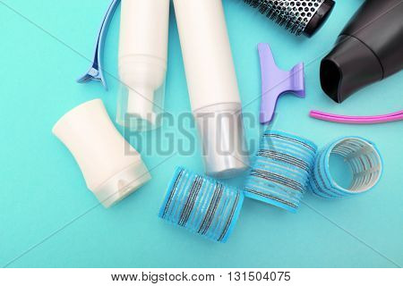 Hairdresser set with various accessories on turquoise background