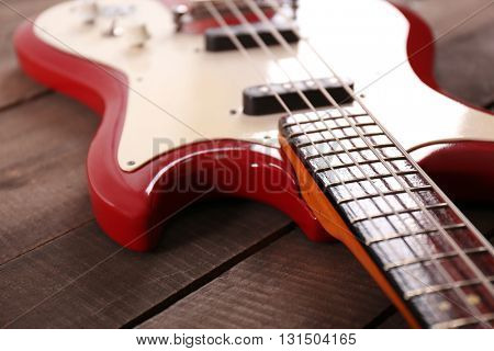 Electric guitar on wooden background