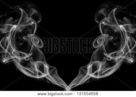 abstract frame from movement of white smoke on black background for graphic design